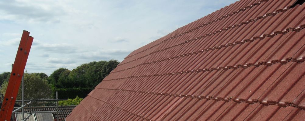 Side view of a red tiled house having work done 3