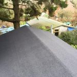 Birds eye view Bitumen shed roof on the edge of a garden