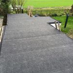 large grey flat roof on a garden outbuilding 2