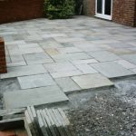 Half way though completing a light grey garden Patio