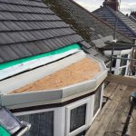 The process of window roof repair on semi circle bay window 2